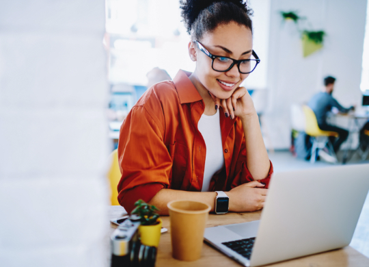 woman watching webinar on her computer
